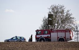 VITIN, CZECH REPUBLIC - 14 April, 2018: Firework and police department checking stack of hay in fire. royalty free stock photo