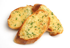 Vitlök & Herb Bread Slices på vit bakgrund Royaltyfri Fotografi