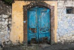 Vitnage blue closed damaged door Stock Images
