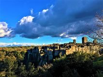 Vitorchiano, Etruscan town near Rome, Italy. Landscape, cliff, Middle Ages buildings and nature. Vitorchiano, Etruscan town near Rome, Italy. Landscape stock image