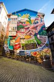 The Painted houses with  artistic graffitties murals Stock Photography