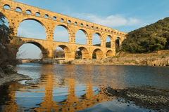 Vitrages in local Pont Du Gard at sunset Royalty Free Stock Photography