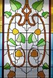 Vitral colorido con adornos florales Imagenes de archivo