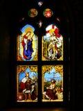 Vitral, janela colorida com um tema cristão Imagens de Stock