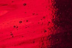 Vitral rojo con las burbujas de aire Fotos de archivo
