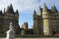 Vitre Castle. On a clear day with clouds and a view of a statue, towers and a gate Stock Image
