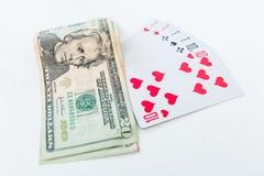 Vitória no pôquer. Dez e dólares Fotografia de Stock Royalty Free