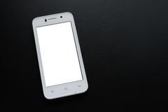 VitSmart telefon med den vita skärmen på den svarta tabellen Arkivbilder