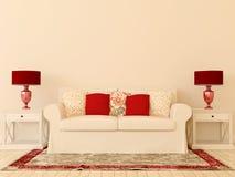 Vitsofa med den röda dekoren Arkivfoto