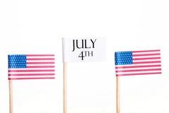 Vitt baner med Juli 4th Arkivfoto