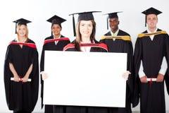 Vitt bräde för doktorand- holding royaltyfria foton