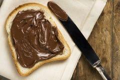 Vitt bröd med Nutella royaltyfria foton