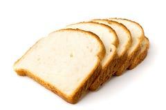Vitt bröd skivade a på vit arkivfoto