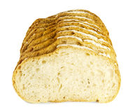 Vitt bröd som huggas av på vit bakgrund royaltyfri bild