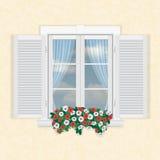 Vitt fönster med slutare och blommor Arkivbilder