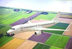 Vitt flygplan som 3D flyger ovannämnt landskap Royaltyfri Bild