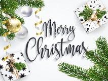 Vitt hälsningkort för jul med gåvaaskar arkivbild