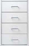 Vitt kabinett med enheter royaltyfria bilder