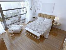 Vitt modernt sovrum med det bruna golvet Arkivfoton