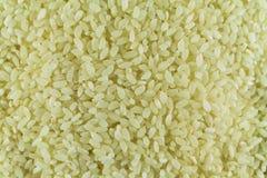 Vitt ris är en näve för det hela fotoet wallpaper royaltyfria foton