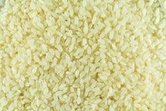 Vitt ris är en näve för det hela fotoet wallpaper arkivfoto