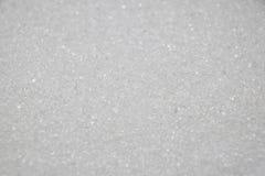 vitt socker flagar bakgrund arkivbild