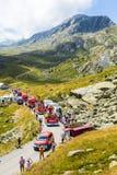 Vittel Caravan in Alps - Tour de France 2015. Col de la Croix de Fer, France - 25 July 2015: Vittel caravan driving on the road to the Col de la Croix de Fer in Stock Photography