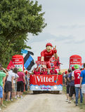 Vittel Vehicle on a Cobblestone Road- Tour de France 2015. Quievy,France - July 07, 2015: Vittel vehicle during the passing of the Publicity Caravan on a Stock Image