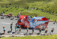 Vittel Vehicle - Tour de France 2014. Col de Peyresourde,France- July 23, 2014: Spectators refreshing under the water spray produced by Vittel vehicle during the Royalty Free Stock Photo