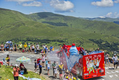 Vittel Vehicle - Tour de France 2014. Col de Peyresourde,France- July 23, 2014: Spectators refreshing under the water spray produced by Vittel vehicle during the Royalty Free Stock Images