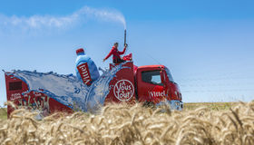 Vittel Vehicle - Tour de France 2016. Saint-Quentin-Fallavier,France - July 16, 2016: Vittel vehicle during the passing of Publicity Caravan in a wheat plain in Stock Photos