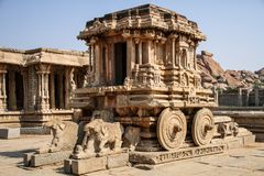 The Garuda shrine in the form of stone chariot at Vitthala temple, Hampi, Karnataka, India. The Vitthala temple has a Garuda shrine in the form of a stone Royalty Free Stock Photos