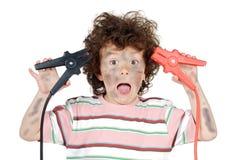 Vittima del ragazzo con elettricità Immagini Stock
