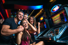 Vittoria sullo slot machine Immagine Stock
