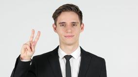 Vittoria, uomo d'affari vittorioso, fondo bianco fotografia stock