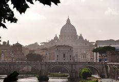 The Vittorio Emanuele II Bridge with the dome of the Basilica of St. Peter in the background Stock Photo