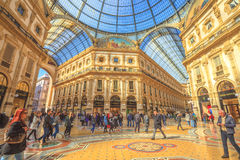 Vittorio Emanuele II crossroad. Milan, Italy - March 7, 2017: crossroad of the Galleria Vittorio Emanuele II arcaded mall with people and famous fashion stores Stock Images