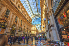 Vittorio Emanuele II Gallery. Milan, Italy - March 7, 2017: interior of the Galleria Vittorio Emanuele II arcaded mall with tourists walking for shopping. In Stock Photo