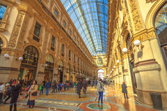 Vittorio Emanuele II hall. MILAN, ITALY- MARCH 7, 2017: tourists walking for shopping inside the Galleria Vittorio Emanuele II gallery in Piazza Duomo square Stock Photography