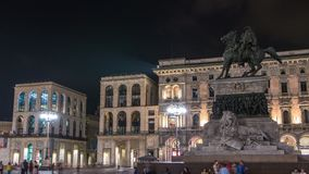 Vittorio Emanuele II statue at Piazza del Duomo timelapse at night. Milan in Lombardy, Italy. Museum on background. Summer day stock video
