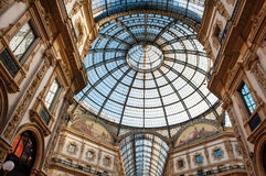 Vittorio Emanuele Milan shopping mall interior. Low angle view toward circular domed ceiling and windows inside the Vittorio Emanuele Milan shopping mall Royalty Free Stock Photos