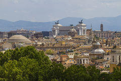 Vittorio Emanuele monument and churches domes  in Rome. Royalty Free Stock Image