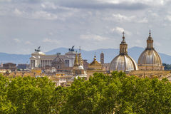 Vittorio Emanuele monument and churches domes  in Rome. Stock Images