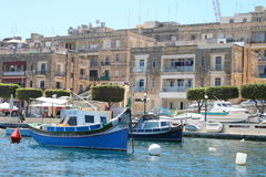 Vittoriosa, Malta. Vittoriosa Harbor with typical Maltese fishing boats and yachts. Island of Malta, Europe. Famous holiday destination due to the unique view Stock Photo