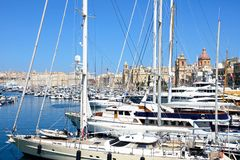 Vittoriosa marina, Malta. Yachts moored in the marina with views towards waterfront buildings and Fort St Angelo, Vittoriosa, Malta, Europe Royalty Free Stock Images