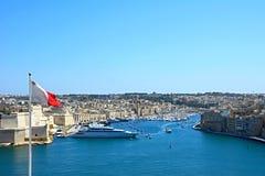 Vittoriosa seen from Valleta. View towards Vittoriosa seen from Valletta with a Maltese flag in the foreground, Valletta, Malta, Europe Royalty Free Stock Image
