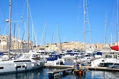 Vittoriosa and Senglea marina, Malta. View of yachts moored in the marina with views towards Senglea to the left and Valletta to the rear, Vittoriosa, Malta Stock Image