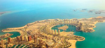 Viva Bahriya aerial. Aerial view of the Pearl-Qatar, the artificial island in Persian Gulf, Doha, Qatar, Middle East. Scenic flight of Viva Bahriya in Maghreb royalty free stock images