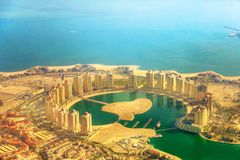 Viva Bahriya scenic flight. Details of towers of the Pearl-Qatar, the artificial island in Persian Gulf, Doha, Qatar, Middle East. Scenic flight of Viva Bahriya stock image