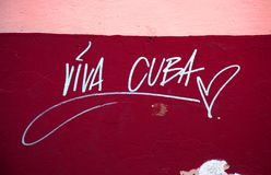 Viva Cuba on the wall. Viva Cuba inscription on a red and pink wall stock images
